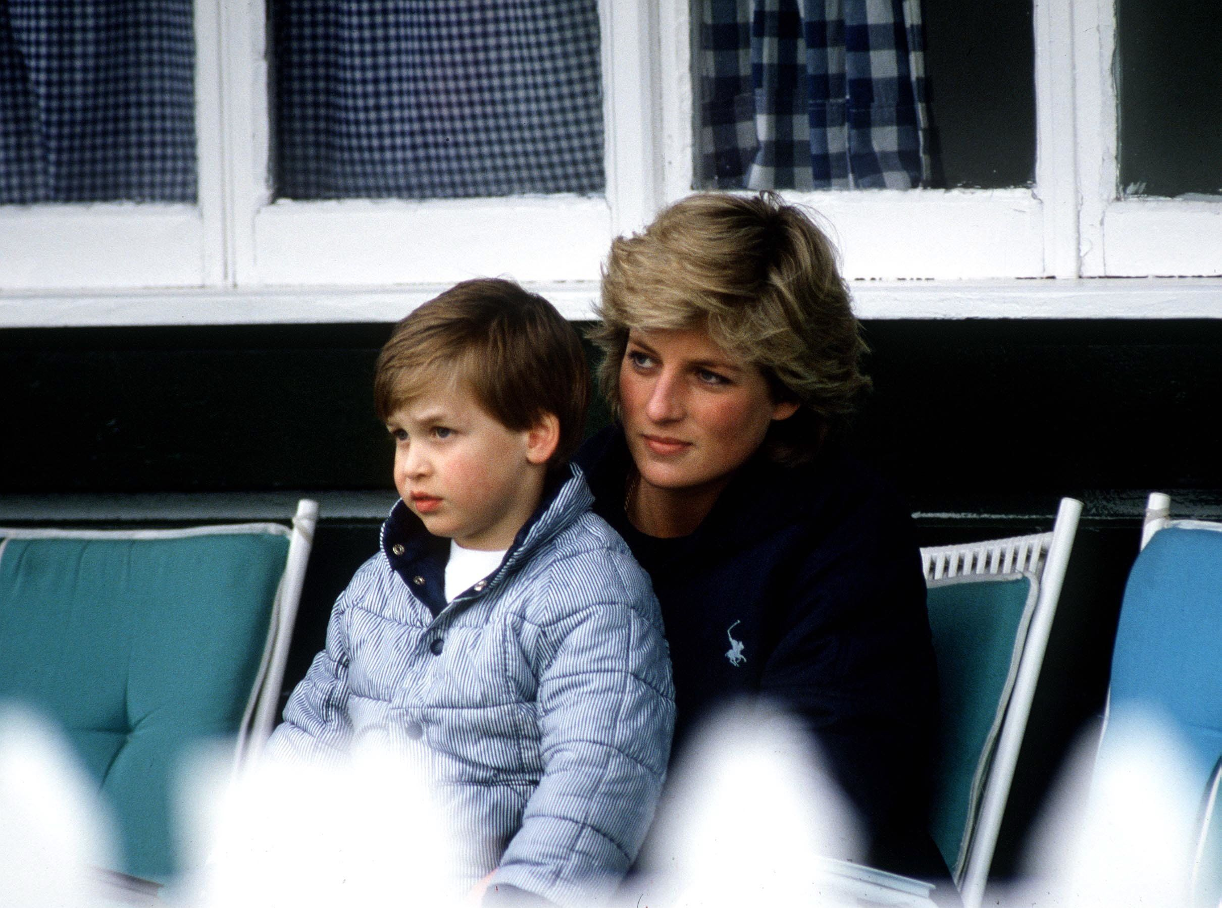 WINDSOR, UNITED KINGDOM - MAY 17:  Princess Diana With Prince William Sitting On Her Lap At Polo.  (Photo by Tim Graham/Getty Images)