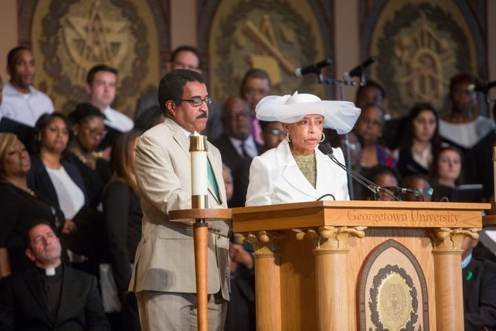 Rev. Leroy Baker, left, and Onita Estes-Hicks, speak during a Liturgy of Remembrance, Contrition and Hope at Gaston Hall on t