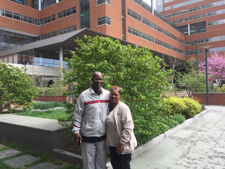 William Glover-Bey and Collie Thomas pose outside the Johns Hopkins Hospital in Baltimore. They are alumni of Turnaround Tues