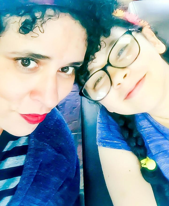 The author and her 9-year-old daughter, who has high-functioning autism.