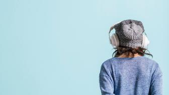 Girl with head phones listening to music