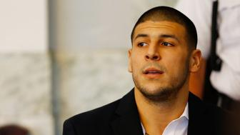 NORTH ATTLEBORO, MA - AUGUST 22: Aaron Hernandez sits in the courtroom of the Attleboro District Court during his hearing on August 22, 2013 in North Attleboro, Massachusetts. Former New England Patriot Aaron Hernandez has been indicted on a first-degree murder charge for the death of Odin Lloyd. (Photo by Jared Wickerham/Getty Images)