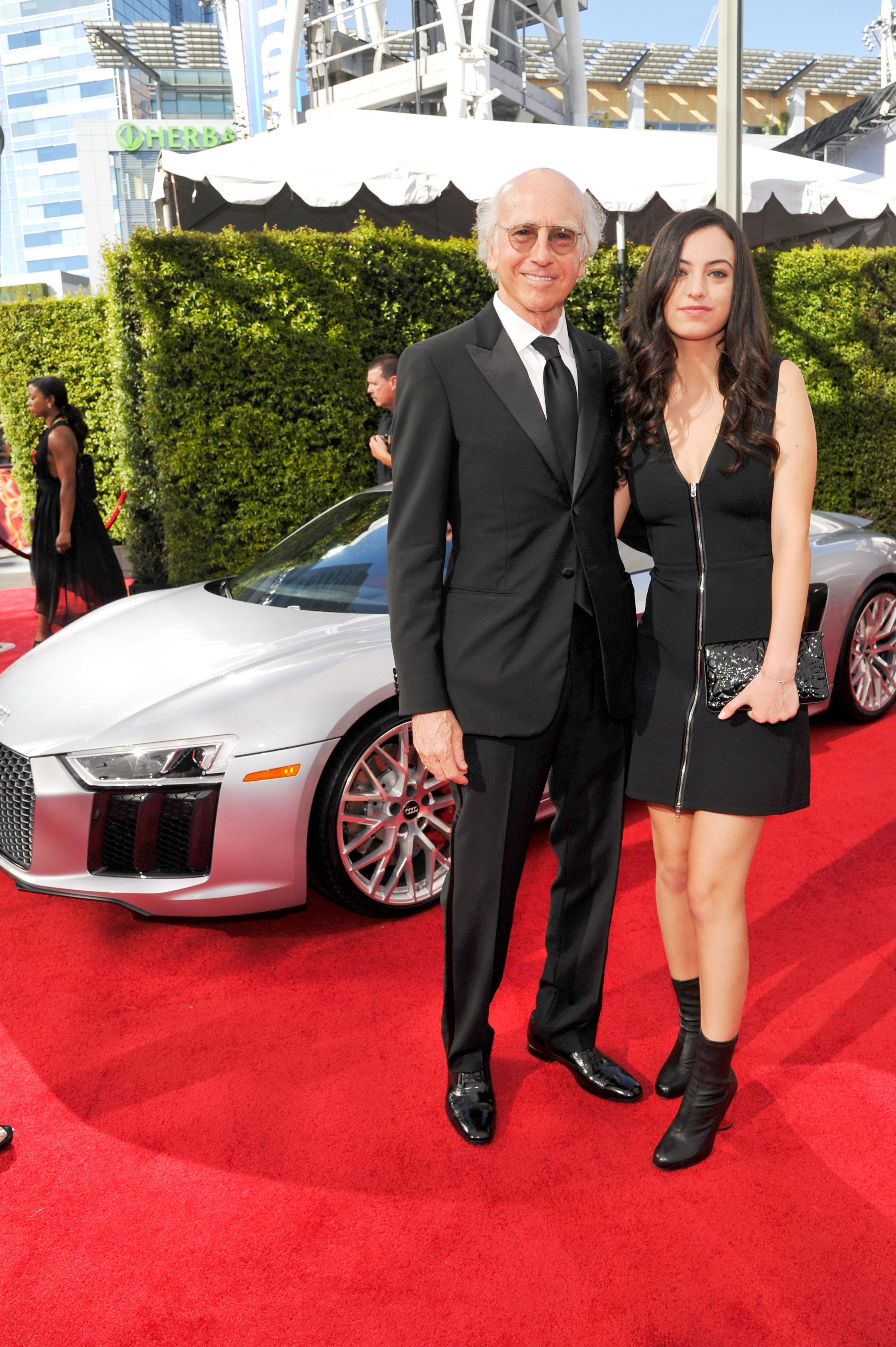 LOS ANGELES, CA - SEPTEMBER 18:  Actor Larry David (L), Cazzie David and Audi at The 68th Emmy Awards on September 18, 2016 in Los Angeles, California.  (Photo by John Sciulli/Getty Images for Audi)