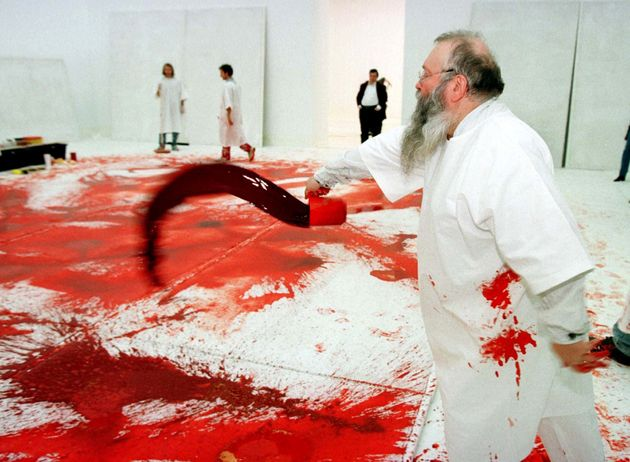 Austrian artist Hermann Nitsch in an earlier happening at Vienna's Modern Art