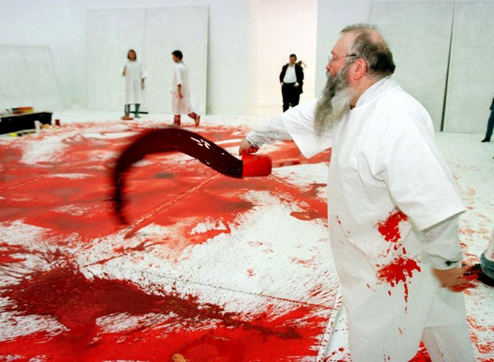 Austrian artist Hermann Nitsch in an earlier happening at Vienna's Modern Art Museum.