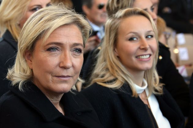 French National Front political party leader Marine Le Pen (L) and politician Marion Marechal-Le