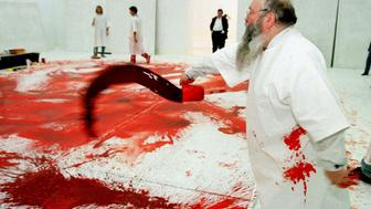 "Austrian artist Hermann Nitsch is at work during his 40th ""blood and black paint"" happening in Vienna's Modern Art Museum October 31. The large-format pictures will be exhibited from the 6th to the 9th November."