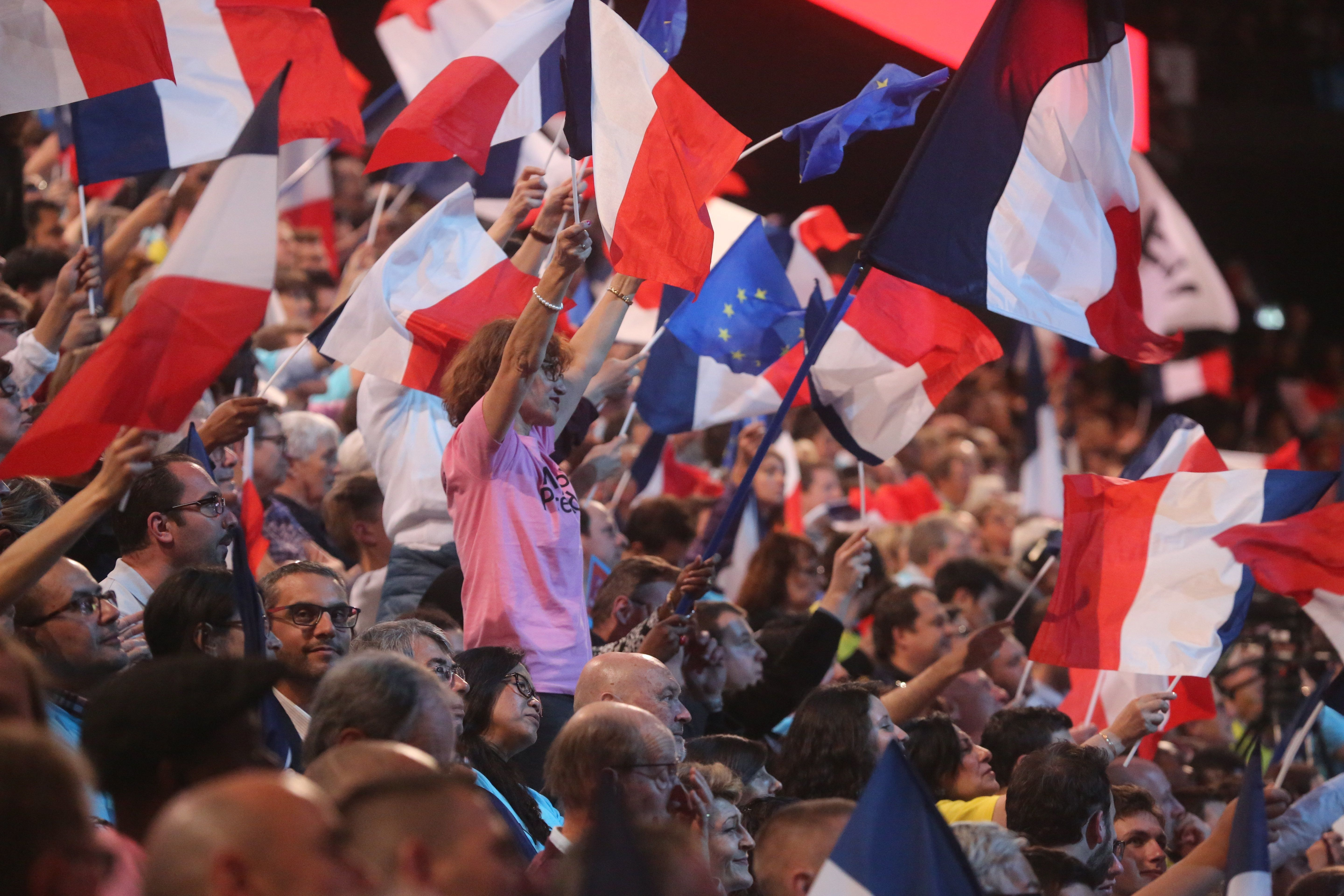 PARIS, FRANCE - APRIL 17: People attend French presidential candidate Emmanuel Macron's campaign rally at AccorHotels Arena on April 17, 2017 in Paris, France. (Photo by Owen Franken/Corbis via Getty Images)
