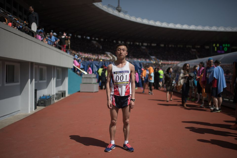 Marathon runner Pak Chol poses for a portrait after winning the Pyongyang Marathon, at Kim Il-Sung stadium in Pyongyang.