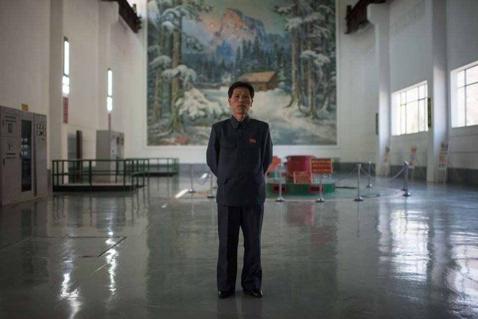 Chief Engineer Choe Yong-Jun poses for a portrait at the Wonsan Youth Power Station, a hydroelectric plant outside the easter