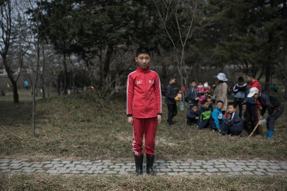 "Kim Hyun-U, 12, poses for a portrait as he takes part in a seasonal initiative referred to as a ""do good things"" campaign, in"