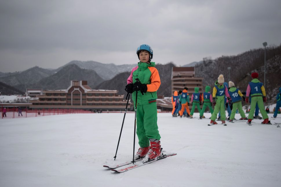 Pak Han-Song, 11, poses for a portrait on a beginner's slope at the Masikryong, or Masik Pass, ski resort near Wonsan. AFP wa