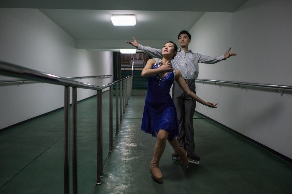 Figure skaters Nam Yong-Myong (left) and Choe Min pose for a portrait in Pyongyang. The skaters were performing at the Paektu