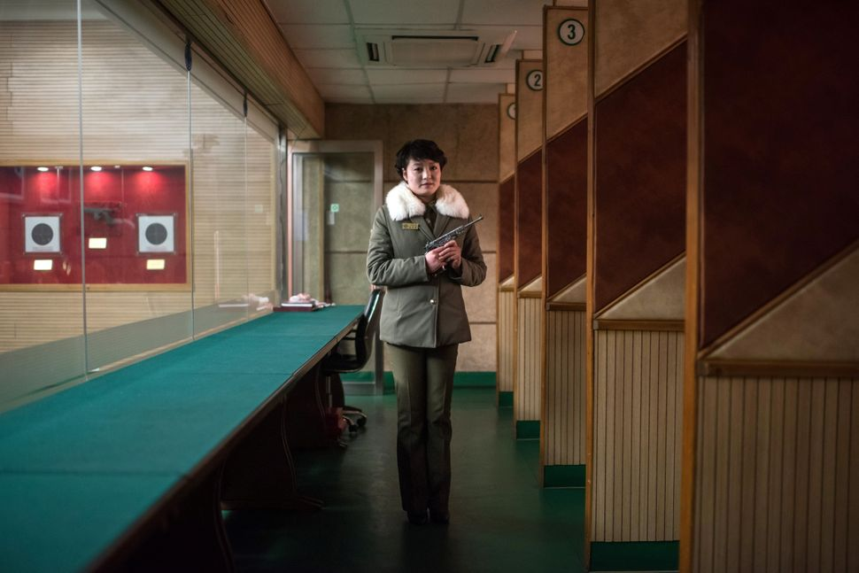 Shooting instructor Kim Su-Ryon poses for a portrait at the Meari Shooting Range in Pyongyang. Kim is holding a Paektusan tar