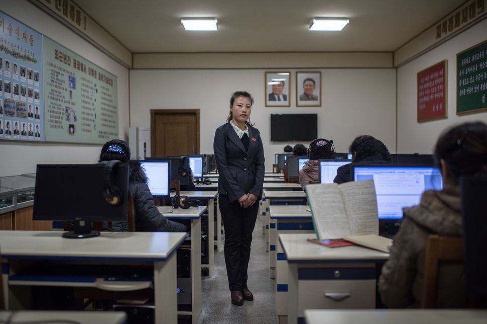 Ri Yong-Hwa, 23, poses for a portrait in a classroom at the Kim Jong-Suk silk mill in Pyongyang. A regular fixture on the iti