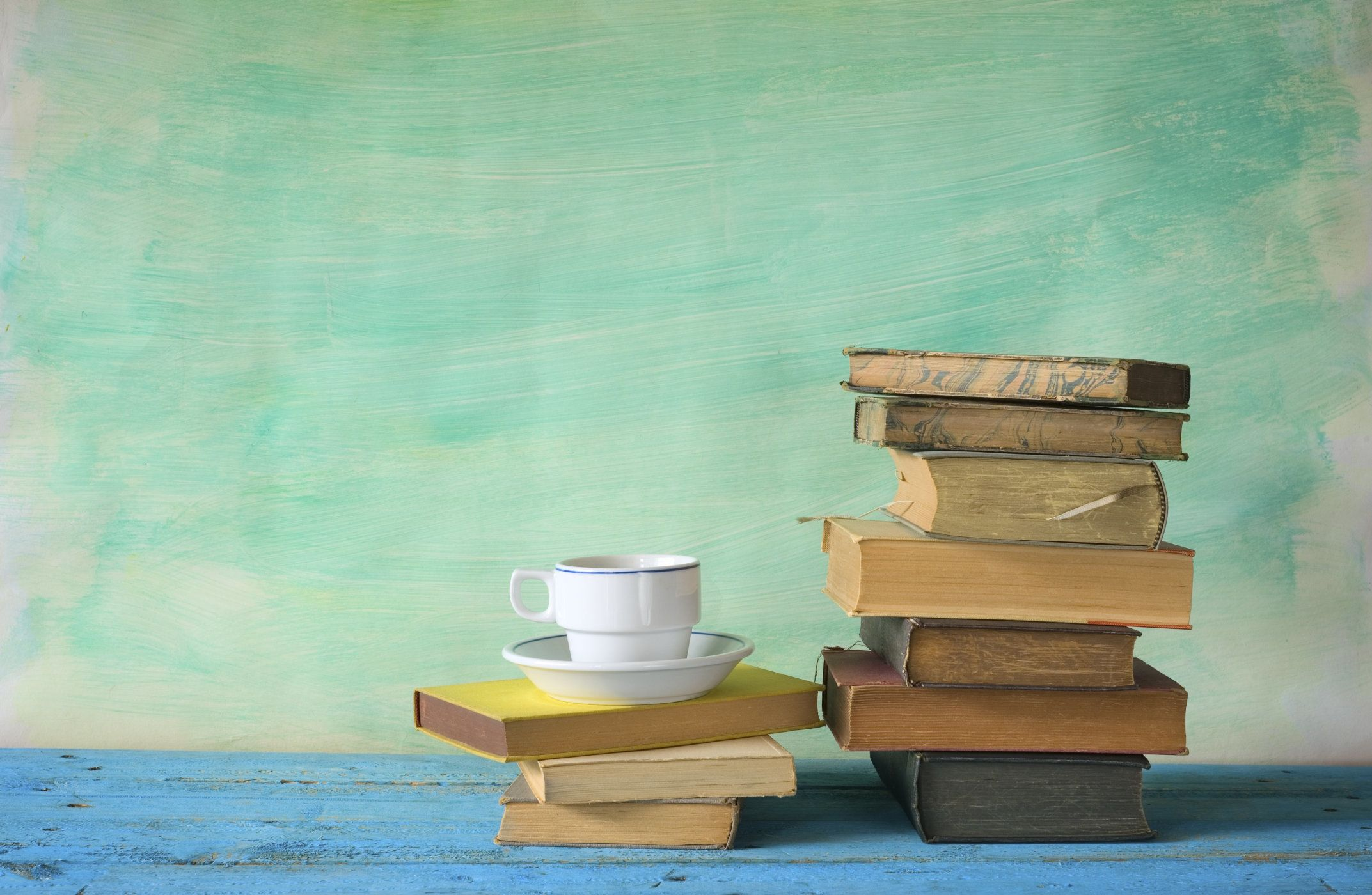 stack of books with a cup of coffee, free copy space