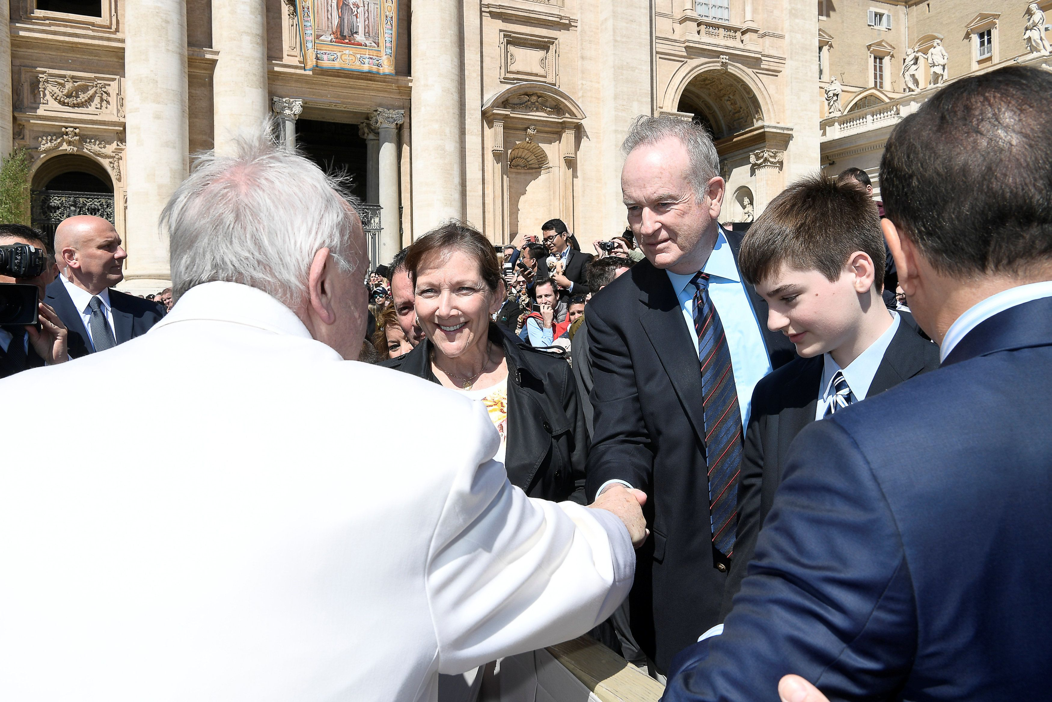 Fox News Channel host Bill O'Reilly shakes hand with Pope Francis during the Wednesday general audience in Saint Peter's squa