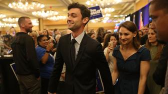 ATLANTA, GA - APRIL 18:  Democratic candidate Jon Ossoff walks with his girlfriend Alisha Kramer after speaking to his supporters as votes continue to be counted in a race that was too close to call for Georgia's 6th Congressional District in a special election to replace Tom Price, who is now the secretary of Health and Human Services on April 18, 2017 in Atlanta, Georgia. The winner of the race would fill a congressional seat that has been held by a Republican since the 1970s.  (Photo by Joe Raedle/Getty Images)