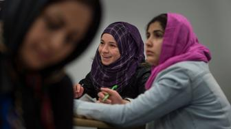 TORONTO, CANADA --  FEBRUARY 19:   Syrian immigrant Raghda Altellawi, 22, center, attends an English class taught by Catherine Porter, not shown, in Toronto, Canada, on Friday, February 19, 2016. (Photo by Nikki Kahn/The Washington Post via Getty Images)