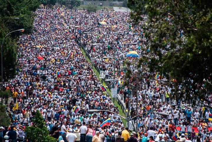 Opposition demonstrators march against the government of Venezuelan President Nicolas Maduro, in Caracas.