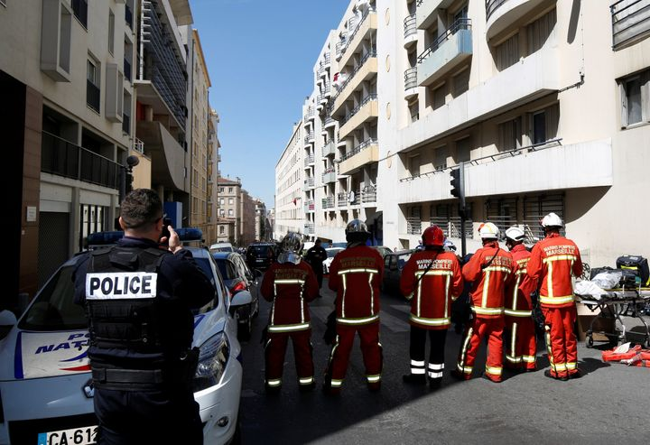 French firefighters block the street as police conduct an investigation after two menwere arrested in Marseille on Apri