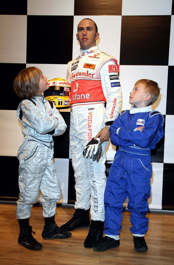 Billy, left, and Myles Apps, pose next to a waxwork of Hamilton after it was unveiled at Madama Tussauds in March, 2009