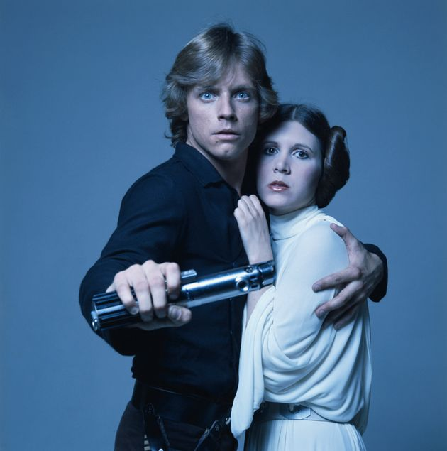 Mark Hamill in character as Luke Skywalker, with co-star Carrie
