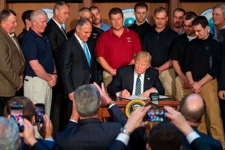Surrounded by miners from Rosebud Mining, Trump signs the Energy Independence Executive Order at EPA Headquarters in Washingt