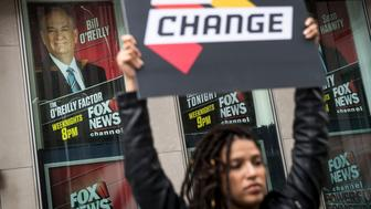 NEW YORK, NY - APRIL 19: Demonstrator Anna Collier Navaroli holds a sign outside of the News Corp. and Fox News headquarters in Midtown Manhattan, April 19, 2017 in New York City. 21st Century Fox, the parent company of Fox News, announced on Wednesday that Fox News television personality Bill O'Reilly will not be returning to the network following numerous claims of sexual harassment and subsequent legal settlements. (Photo by Drew Angerer/Getty Images)