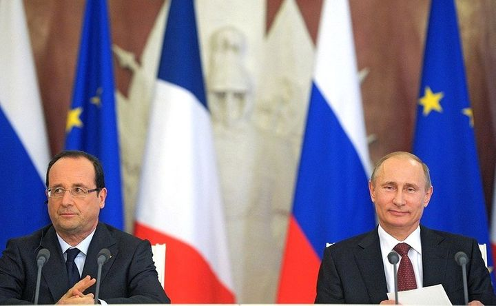Vladimir Putin, here with French President Francois Hollande, has big plans for Europe.