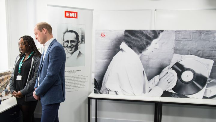 The Duke of Cambridge listens to a recording of King George VI during a visit to open the Global Academy.