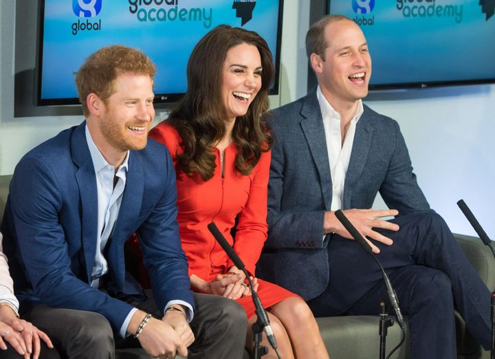 Prince William, Duke of Cambridge, Britain's Catherine, Duchess of Cambridge and Britain's Prince Harry tour a TV studio during the official opening the Global Academy.