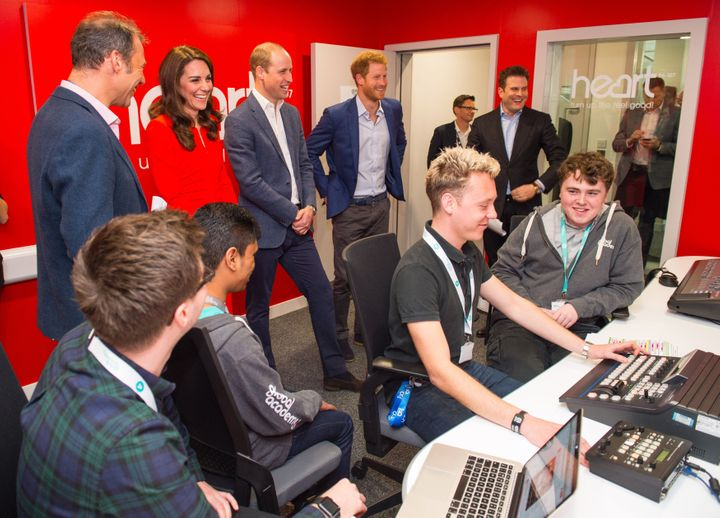 Duchess of Cambridge, Duke of Cambridge and Prince Harry visit a radio studio control room during the official opening of the Global Academy.