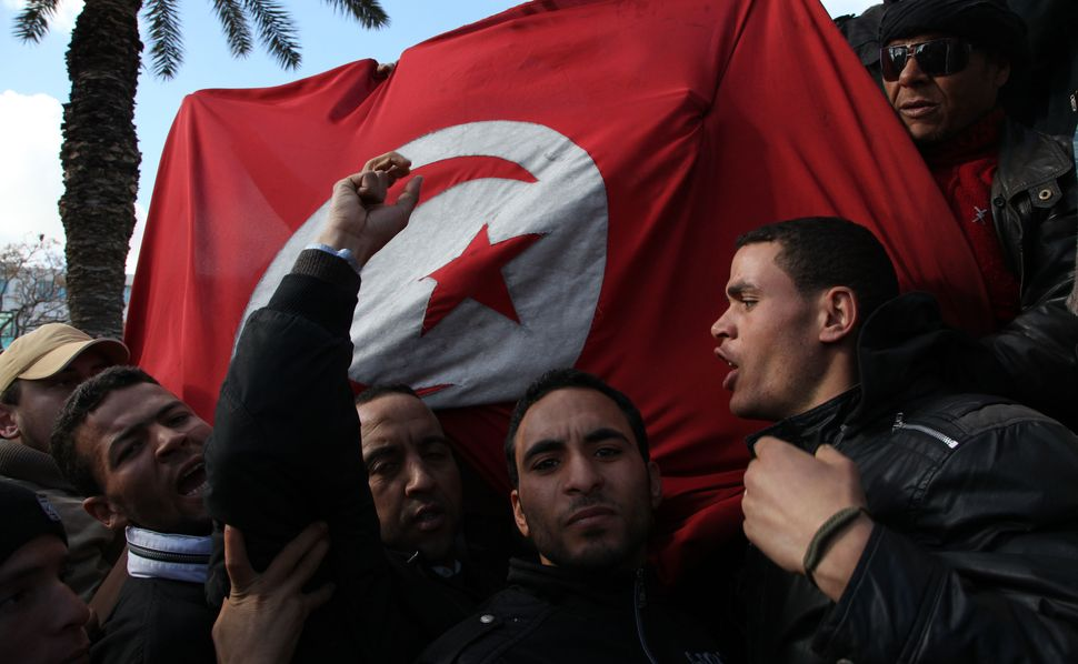 """Tunisians kicked off what became known as the """"Arab Spring"""" in 2011, but the revolution failed to easemany of their&nbs"""