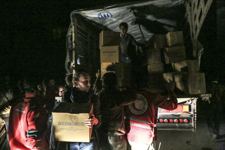 The Syrian Arab Red Crescent and local Syrian committees unloading trucks with food and medicine for a besieged city. But all
