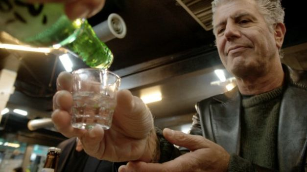 Anthony Bourdain being served a shot on Parts Unknown.