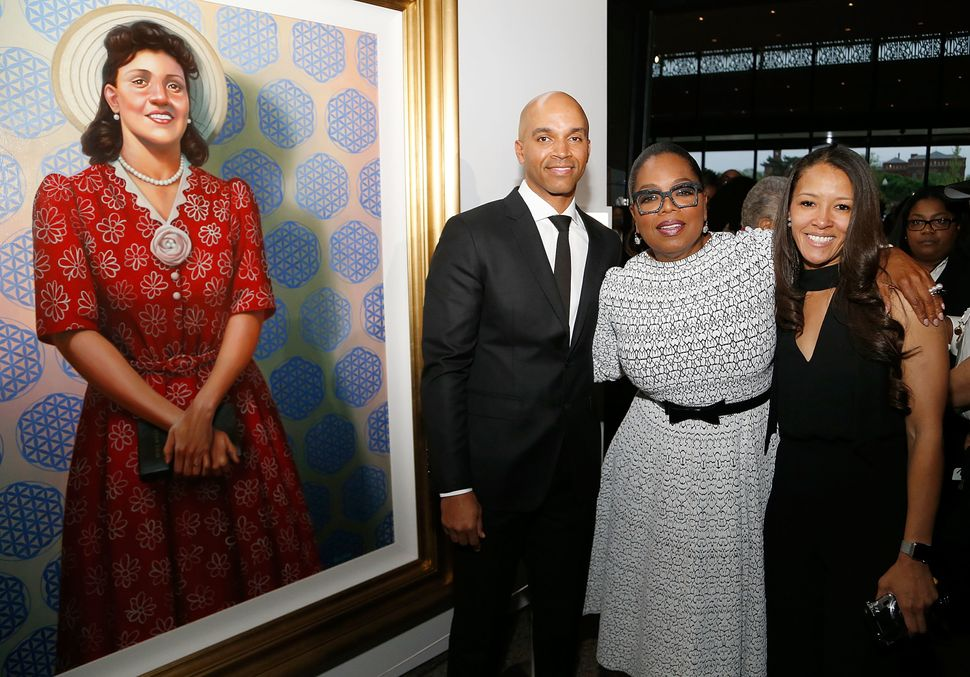 Oprah Winfrey, center, Dr. Jungmiwha Bullock, right, and artist Kadir Nelson, left, with his painting of Henrietta Lacks, att