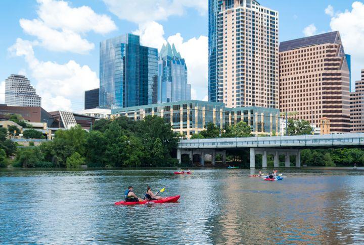 People canoeing on Lady Bird Lake in Austin
