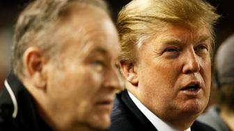 NEW YORK - MAY 15: Donald Trump watches from the stands along with news commentator Bill O'Reilly during the game between the New York Yankees and Minnesota Twins at Yankee Stadium on May 15, 2009 in the Bronx borough of New York City.  The Yankees defeated the Twins 5-4. (Photo by Joe Robbins/Getty Images)