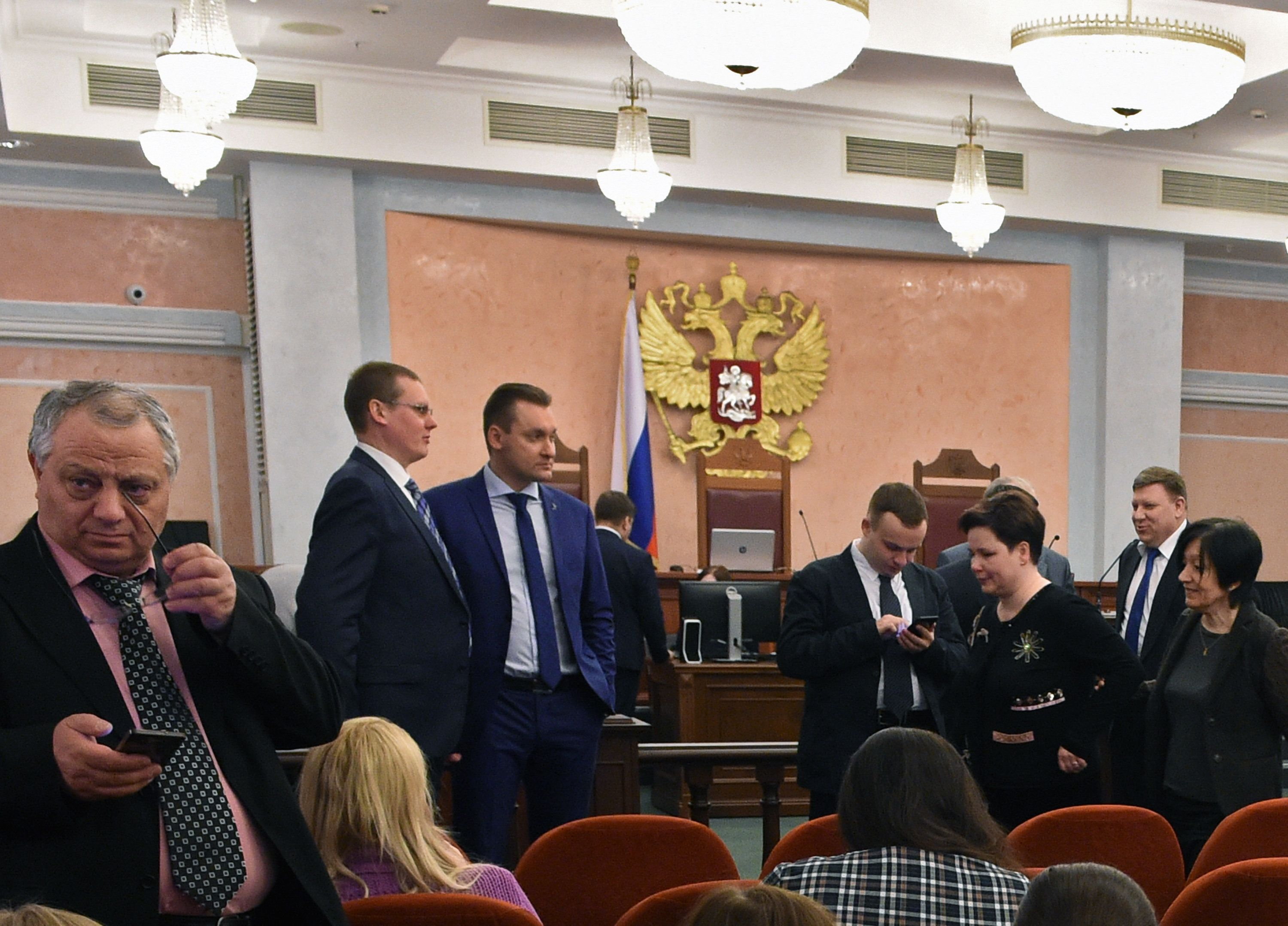 Participants attend a hearing on the justice ministry request to ban the Jehovah's Witnesses at Russia's Supreme Court in Moscow on April 20, 2017. Russia's Supreme Court on April 20 issued a ruling banning Jehovah's Witnesses after finding the group to be extremist. / AFP PHOTO / Vasily MAXIMOV        (Photo credit should read VASILY MAXIMOV/AFP/Getty Images)