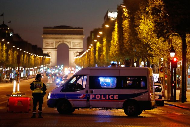 Police secure the Champs Elysees Avenue after one policeman was killed and another wounded in a shooting...