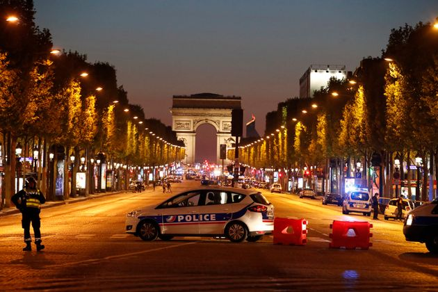 Police secure the Champs Elysee Avenue after one policeman was killed and another wounded in a shooting...