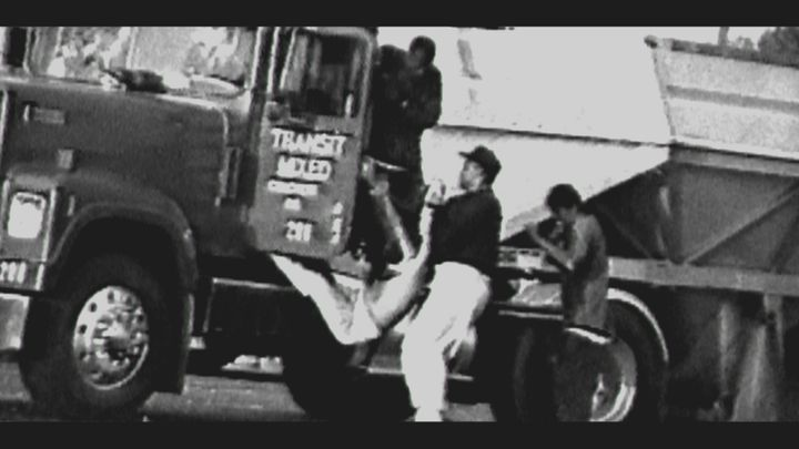 Reginald Denny being dragged from his truck.