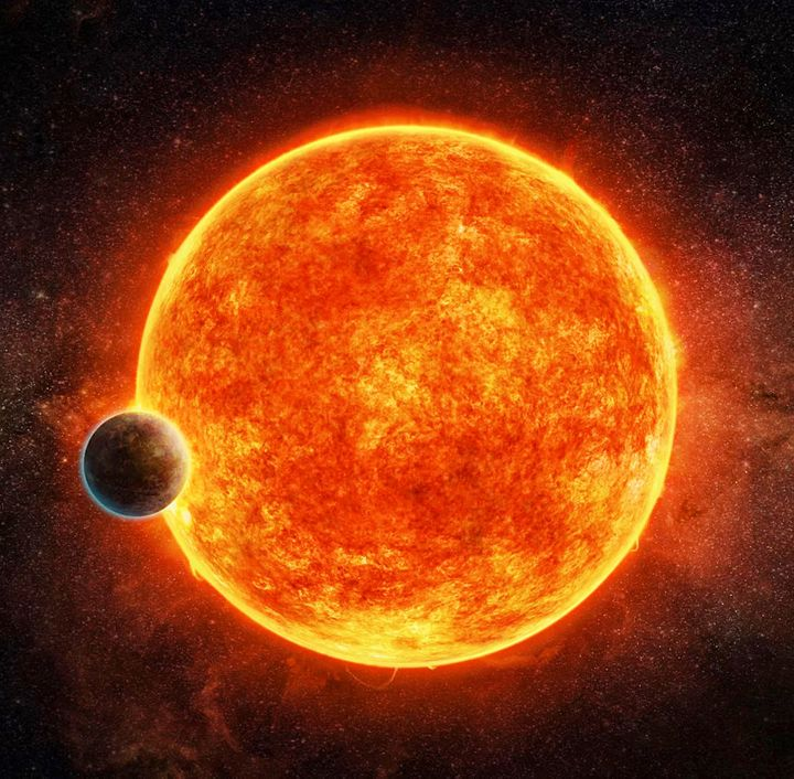 "In an artist's impression, the possible ""super-Earth"" planet LHS1140b begins to cross the star LHS 1140. The planet shows ear"