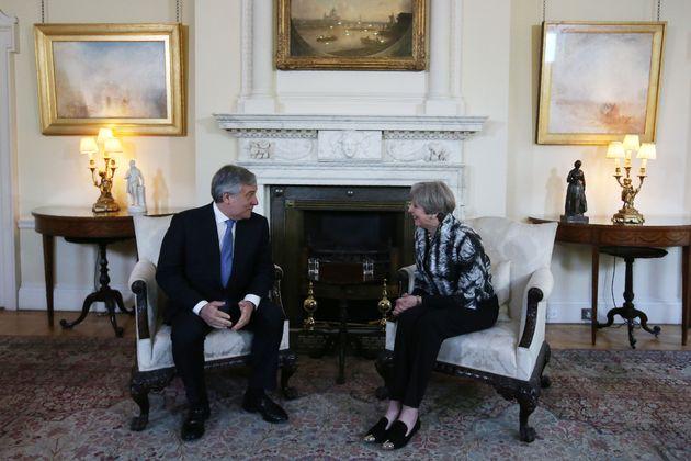 European Parliament President Antonio Tajani talking to Theresa