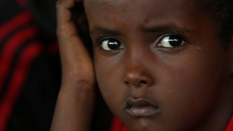 A migrant child rests on the Malta-based NGO Migrant Offshore Aid Station (MOAS) ship Phoenix after being rescued from a wooden boat in the central Mediterranean in international waters off the coast of Sabratha in Libya, April 15, 2017.    REUTERS/Darrin Zammit Lupi