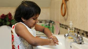 Nabiha A Chowdhury, 7, demonstrates her process for removing potential lead from her hands by washing them at her home in Buffalo, New York March 30, 2017.  REUTERS/Lindsay DeDario To match Special Report USA-LEAD/STATES