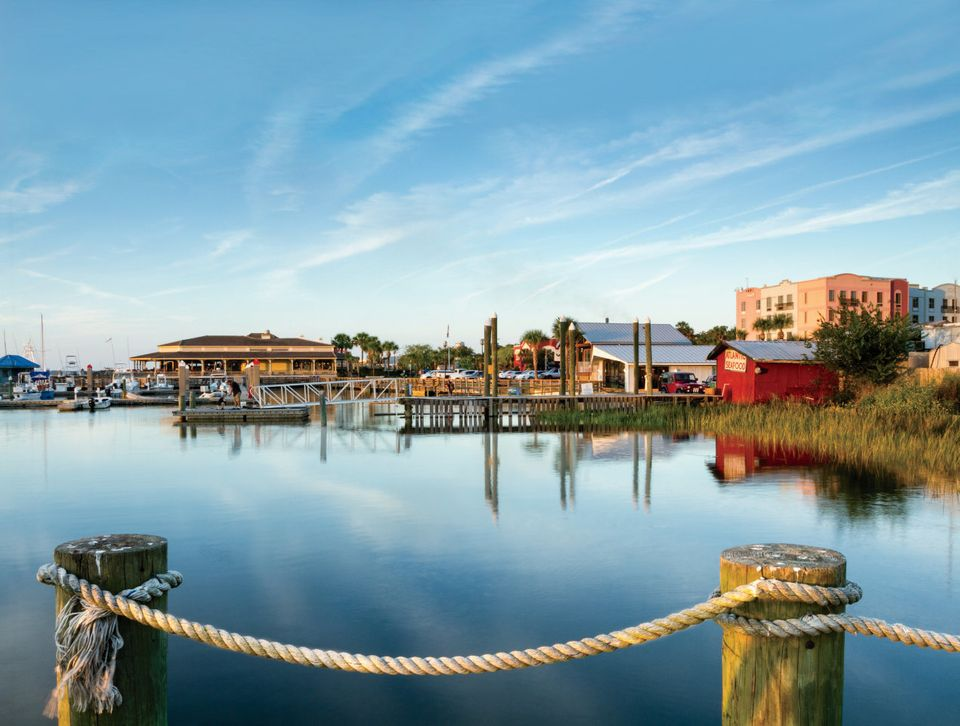 "Life in this historic town&nbsp;includes <a href=""https://www.huffpost.com/entry/10-best-beach-towns-in-fl_b_4759583"">horse-d"