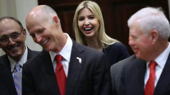 WASHINGTON, DC - APRIL 19: Ivanka Trump (C) joins her father, U.S. President Donald Trump, and representatives of veterans' organizations, politicians and members of his administration during the signing ceremony for the Veterans Choice Program And Improvement Act in the Roosevelt Room at the White House April 19, 2017 in Washington, DC. The legislation, which expiries later this year, sets aside $10 million to extend the Choice Card program, which allows veterans who face lengthy wait times for VA hospital appointments or live more than 40 miles from VA clinics to use the program to seek private-sector medical care instead.  (Photo by Chip Somodevilla/Getty Images)