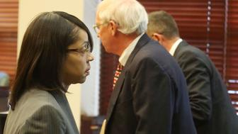 Orange/Osceola State Attorney Aramis Ayala, left, leaves the courtroom after asking for Markeith Loyd's case to pause Monday, March 20, 2017 while she researches if Gov. Rick Scott had the authority to pull her off after she announced she wouldn't be seeking the death penalty. Loyd was in court Monday morning for the first time since Ayala, the elected state attorney for Orange and Osceola counties, said she would not seek the death penalty for Loyd. (Red Huber/Orlando Sentinel/TNS via Getty Images)
